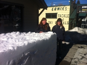 Pictured here, CANDACE LOGUE AND LESLEY MAIN stand beside the snow block for the Sierra Inn, where the party gets started on Friday evening!