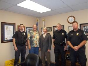 Officer Daniel Hansen, Chief Watson, Reserve Officer Worcester, Detective Doug Hornbeck, and Officer Andy Lehr.