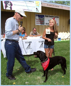 Ted Schade interviewing Alicia Ramirez with Trace, her adopted 3-legged dog - 1st Place Outstanding Adopted Pet — at Tri-County Fairgrounds.