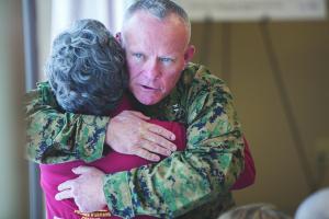 Major General Lawrence Nicholson hugs DSES Director Kathy Copeland.