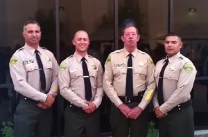 "(from left to right): Lieutenant Eric Pritchard, Seneca Willis, Sheriff ""Bill"" Lutze, Angilberto Castaneda"