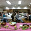 About 50 people gathered in the Independence Legion Hall and enjoyed a light meal featuring locally grown produce, locally made baked goods and homemade entrees. Members of the Owens Valley Growers Cooperative presented their plans to reopen Mair's Market in Independence. Photo by Tamara Cohn.