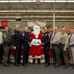 Representatives from most of the articipating agencies.  They are, left to right, Captain Rich Watt, US Forest Service; Lieutenant Bill Dailey, California Department of Fish and Wildlife; Chief Dan Watson, Mammoth Lakes Police Department; Chief Chris Carter, Bishop Police Department; Santa Claus; Sergeant Rick Moberly, Mammoth Lakes Police Department; Undersheriff Keith Hardcastle, Inyo County Sheriff's Office; Sheriff Ralph Obenberger, Mono County Sheriff's Office; and Captain Tim Noyes, Bishop CHP.   Photos are courtesy of Erin Gladding Photography.