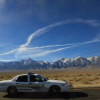 Contrails over the Sierra - photograph by Andrew Kirk