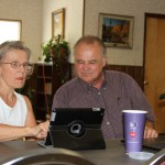 Prudence Carr gets individual attention from computer class instructor Charles James