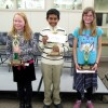 Spelling Bee Winners (left to right): Rose Bracken (1st Place from Bishop Elementary), Mahdi Ayman (2nd Place from Home Street) and Lyndsey Rowan (3rd place from Home Street)