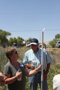 Paula Escaufedo, head of the site visit from the Department of Natural Resources, and Randy Short get a look at the tule tool.