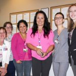 NIHD's Moonlight Mammogram team pause for a photo at the start of what would be a busy evening. The team is, left to right, Admission Services Receptionist Natalie Hollowell-Santana, Mammography Technicians Cathy Poquette and Krissy Alcala, Interpreter Veronica Gonzalez, Patient Navigator Rosie Graves, Mammography Technician Katie Galvin and Admission Services Clerk Lauren Dunlap. Photo by Barbara Laughon/Northern Inyo Healthcare District