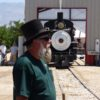 Dave Mull, of Lone Pine, gets ready to drive the ceremonial spiked during the July 3 dedication of the Larry Peckham Memorial Engine House on the grounds of the Eastern California Museum in Independence, the new permanent home of the fully restored Union Pacific Engine 18, The Slim Princess. The fully restored, operational narrow gauge steam locomotive, in the background, ran down the track to the cheers and applause of several hundred spectators. Photos by Jon Klusmire.