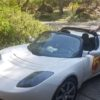 To kick off our event weekend, on Saturday, Tom Ekleman's Tesla Roadster will be the pace car for Gran Fondo on Saturday at the 5 am start. A zero emissions Tesla Roadster. The cyclists requested an electric vehicle to avoid inhaling nasty fumes of a gas car at the start of their 100 mile journey.  Also pictured, Raejean Fellows' 2018 Mitsubishi Outlander, the World's Best Selling Plug In Hybrid Crossover, taking a charge from her home charger in her Snowcreek V residence. Free rides in the Outlander and Teslas on Sunday, September 9th.
