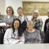 Tracy Aspel, NIHD's Chief Nursing Officer, back row, far left, presents a $1,132 donation from the employees of NIHD to the Eastern Sierra Cancer Alliance Board of Director. The funds were raised through the sale of pink t-shirts during Breast Cancer Awareness Month. Shown accepting the donation from Aspel are ESCA Board members, left to right, back row: Andrea Shallcross, Norma Crider, Sherry Nostrant, and ESCA founder Pat Ramirez. Front row: Rose Graves, Cheryl Underhill and Debbie Christensen.  Photo by Barbara Laughon/Northern Inyo Healthcare District
